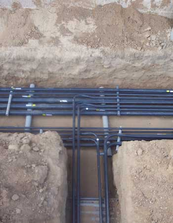 Organised clusters of pipes in a trench