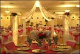 Function room decorated for a wedding (center)