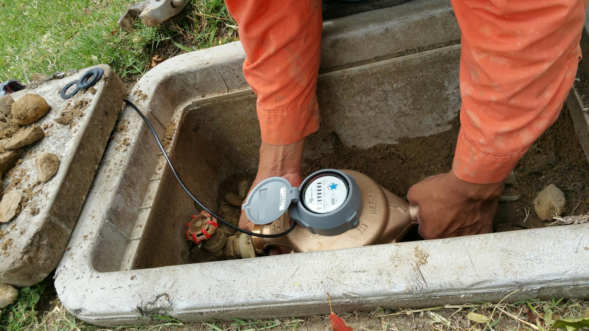 Water meter being inspected